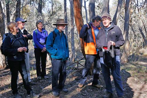 Bernard addressing the group at Sanger's hut site.